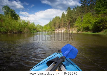 Blue paddle lying on kayak