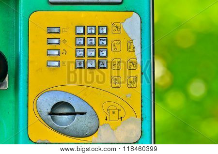 Buttons street payphone on green nature background