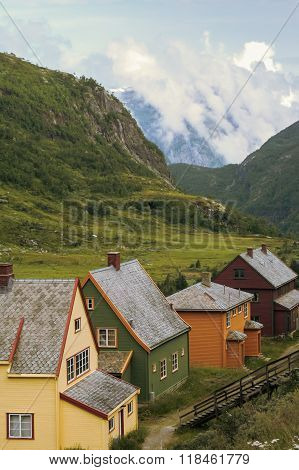 Country houses in village in Norwegian, fjords,landscape ,outdoors,vertical photo