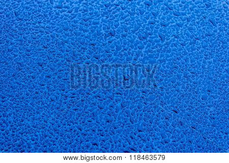 Waterdrops On Blue Car Paint As Underground