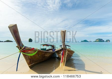 Longtail Boats Floating On Transparent Water