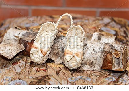 Pair Of Russian Souvenir Wicker Shoes For Children On Birch Log