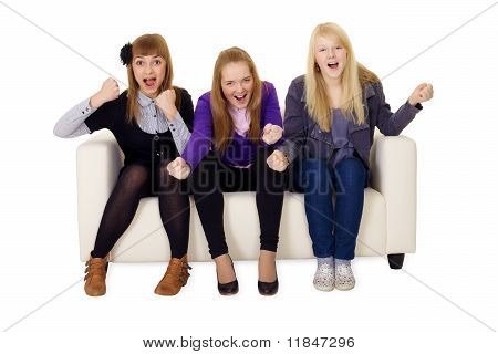 Jubilant Young Woman On Sofa
