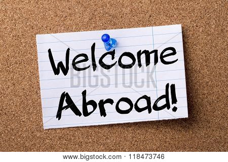 Welcome Abroad! - Teared Note Paper Pinned On Bulletin Board