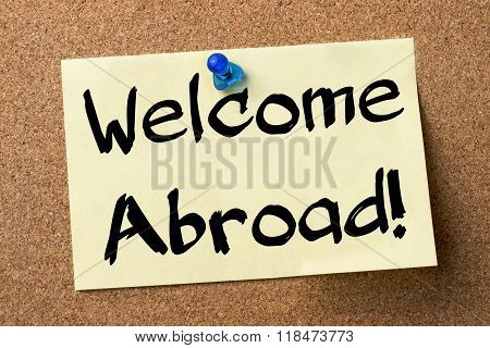 Welcome Abroad! - Adhesive Label Pinned On Bulletin Board
