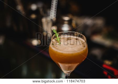 Wine Glass With Cocktail On Bar Background
