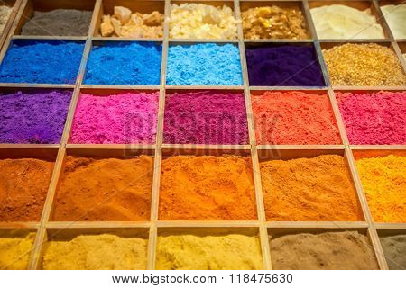 Colorful sands in wooden box