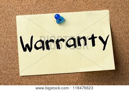 Warranty - Adhesive Label Pinned On Bulletin Board