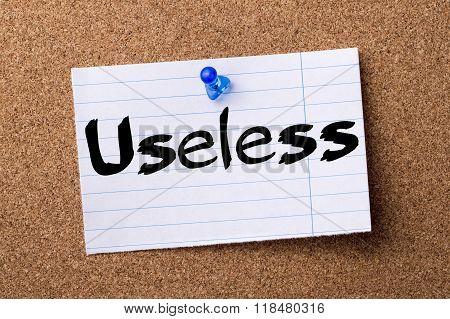 Useless - Teared Note Paper Pinned On Bulletin Board