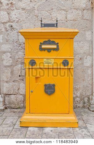 Retro Style Yellow Mail Box In Kotor, Montenegro