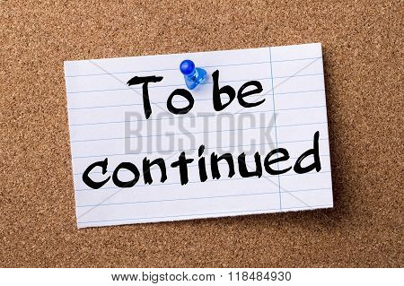 To Be Continued - Teared Note Paper Pinned On Bulletin Board