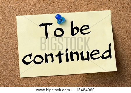 To Be Continued - Adhesive Label Pinned On Bulletin Board