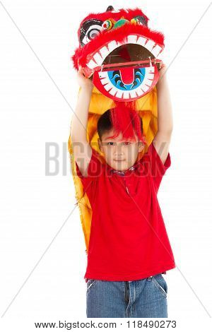 Asian Little Boy In Chinese Lion Custome Dance During Chinese New Year Celebration