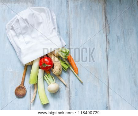 Vegetables in chef's hat cooking food abstract concept