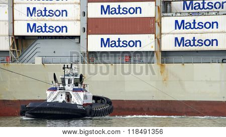 Tugboat Revolution Pushing Cargo Ship Maui To The Dock