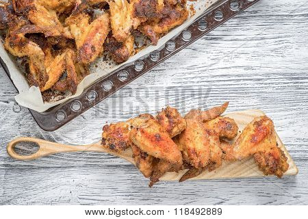 Roasted Spicy Chicken Wings On Tray And Cutting Board With Copy Space