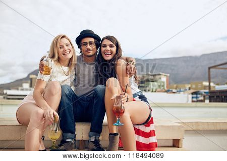 Best Friends Hanging Out On A Roof With Drinks