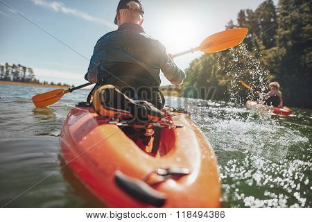 Man In Kayak Paddling On Lake