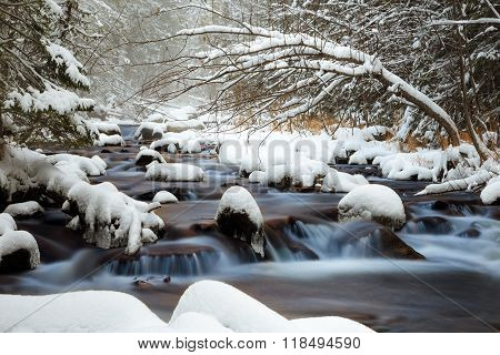 raging river cold water, russian forest, snowy river, river with snowy stones in forest