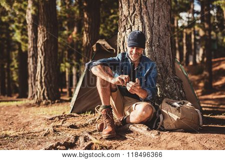 Senior Man Sitting At Campsite