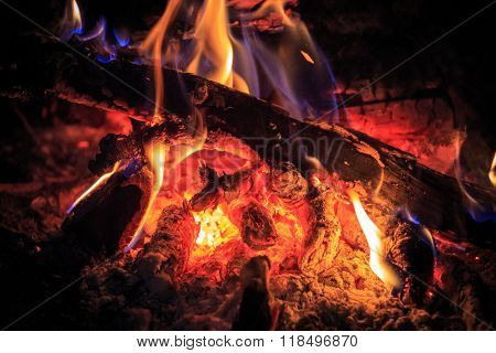 hot flame on embers - abstract background