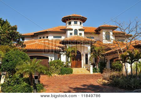 Spanish style home with tower, tiled roofs