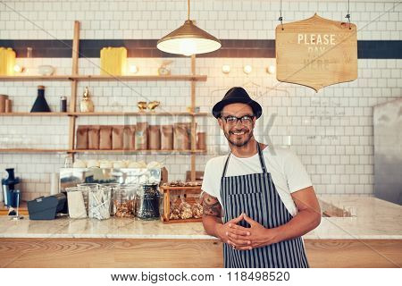 Male Barista Standing At Coffee Shop