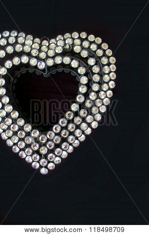 Diamante heart on black background valentine decoration
