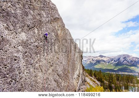 Climbing Steep Rock Walls at the Grassi Lakes near Canmore