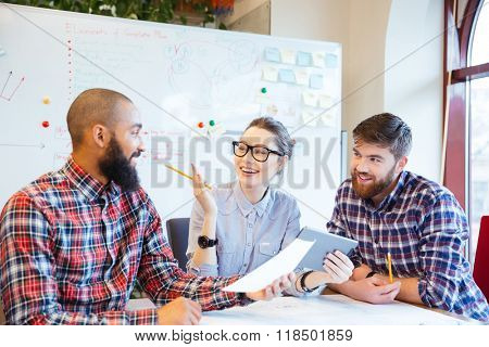 Multiethnic group of happy business people working together in office