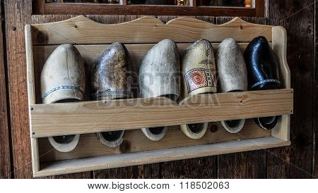 Old clogs in a shell on the wall