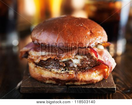 juicey gourmet cheeseburger with melted pepper jack and strips of crispy bacon