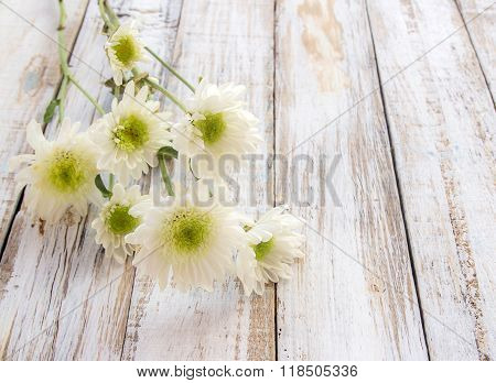 Flowers On White Wood Table