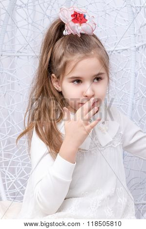 Girl touching her mouth by finger