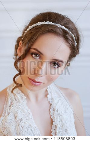 Bridal Hairstyle And Makeup. Young Woman Wearing Headpiece.