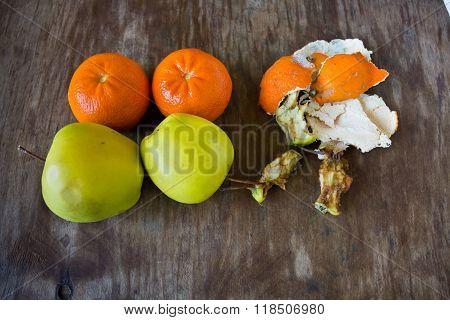Fresh fruits near rotten