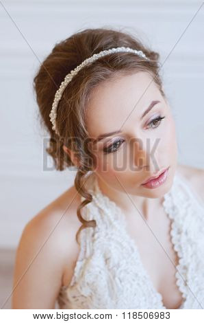 Bridal Fashion. Tender Woman With Brown Hair And Pearl Headpiece.