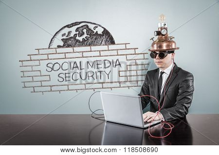 Social media security concept with vintage businessman and laptop