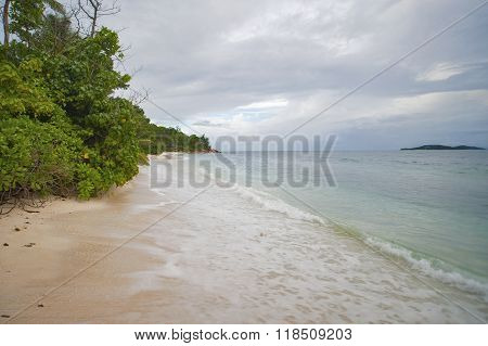 Beach On The Seychelles In Cloudy Weather..