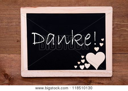 Blackboard With Wooden Hearts, Text Danke Means Thank You