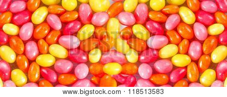 Background of colored candies in the form of eggs
