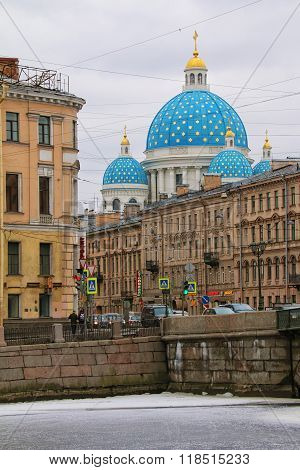 Cathedral dome behind apartment building near the river