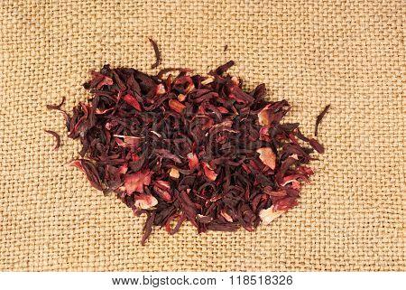 Hibiscus Tea Macro Dry Flower On Sackcloth Background