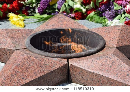 Eternal Flame With Flowers Assigned To It