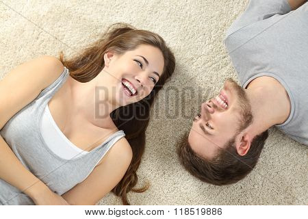 Happy Couple Lying And Laughing