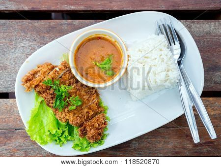 deep fried pork with rice on table