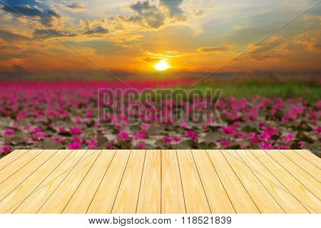 Defocus And Blur Image Of Old Wood And Beautiful Sunset ,thailand For Background Usage