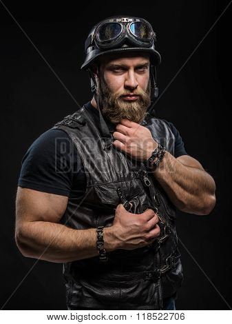 Portrait Handsome Bearded Biker Man In Leather Jacket And Helmet Over Black Background.