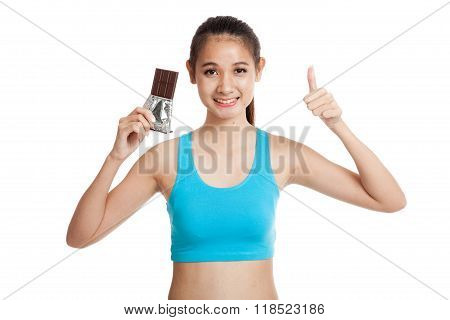 Beautiful Healthy Asian Girl Thumbs Up With Chocolate