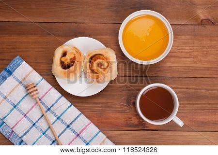 Tea With Honey And Cookies On The Kitchen Table.